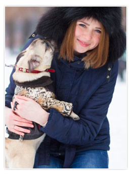 Girl in the Snow Hugging her Pug